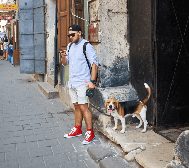 dog owner with retractable dog leash
